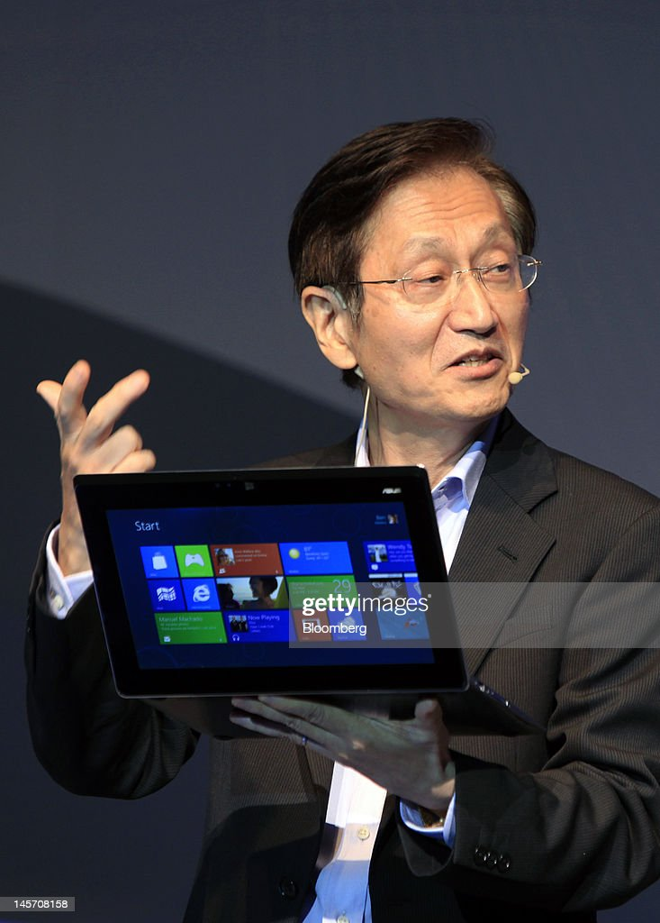 Jonney Shih, chairman of Asustek Computer Inc., presents the ASUS Taichi at a news conference in Taipei, Taiwan, on Monday, June 4, 2012. Asustek today previewed a tablet using ARM Holdings Plc technology and running Microsoft Corp.'s Windows 8 operating system. Photographer: Ashley Pon/Bloomberg via Getty Images