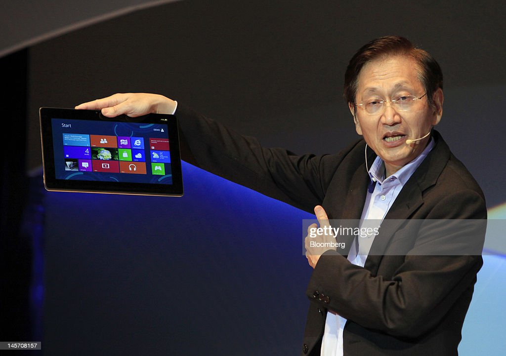 Jonney Shih, chairman of Asustek Computer Inc., presents the new ASUS Transformer AiO at a news conference in Taipei, Taiwan, on Monday, June 4, 2012. Asustek today previewed a tablet using ARM Holdings Plc technology and running Microsoft Corp.'s Windows 8 operating system. Photographer: Ashley Pon/Bloomberg via Getty Images