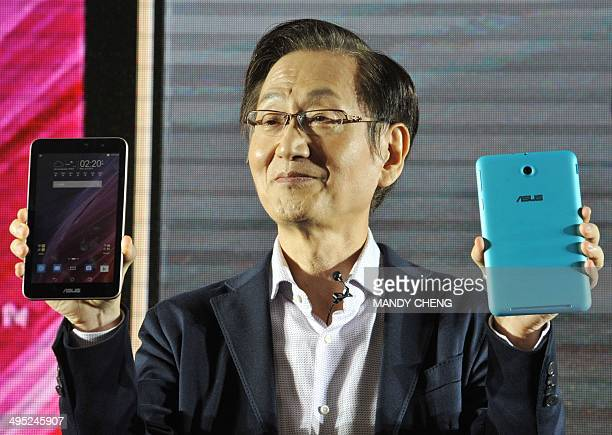 Jonney Shih the chairman of Taiwanese electronics company ASUS introduces the company's new 'ASUS Memo Pad' during a press conference ahead of the...
