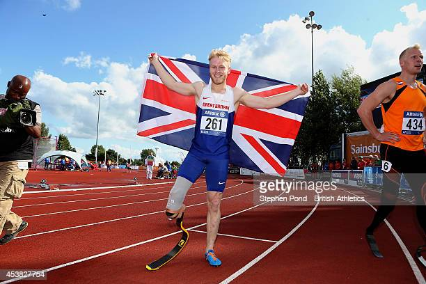 Jonnie Peacock of Great Britain celebrates winning the Men's 100m T44 event during day one of the IPC Athletics European Championships at Swansea...