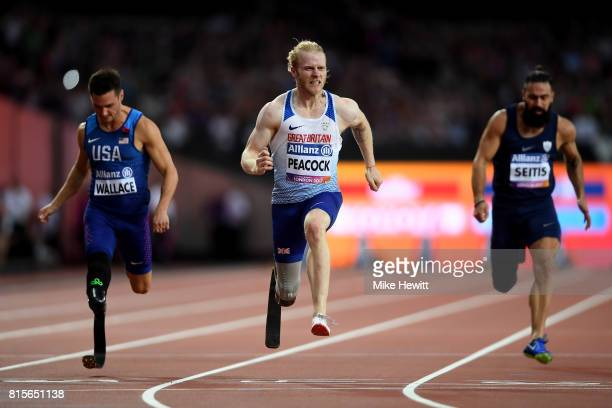 Jonnie Peacock of Great Britain crosses the line to win the Men's 100m T44 Final ahead of Jarryd Wallace of the USA and Michail Seitis of Greece...
