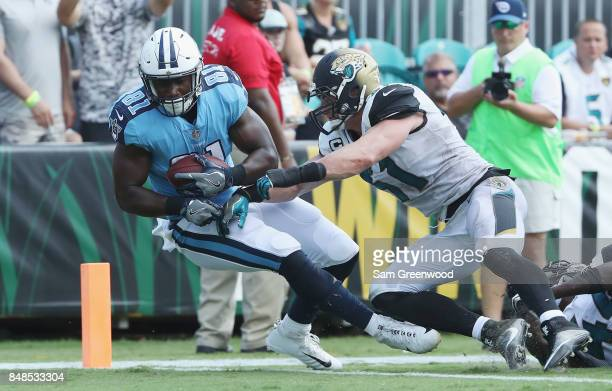 Jonnu Smith of the Tennessee Titans scores a 32yard touchdown the second half in front of Paul Posluszny of the Jacksonville Jaguars at EverBank...
