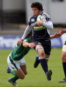 Jonny Baird of Scotland breaks loose during the IRB Junior World Championships game between Ireland and Scotland on June 22 2008 at Rodney Parade...