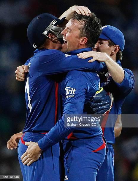 Jonny Bairstow and Graeme Swann of England celebrate after dismissing Kumar Sangakkara of Sri Lanka during the Super Eights Group 1 match between...