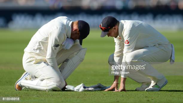 Jonny Bairstow and Joe Root of England after Bairstow injured his hand during the third day of the 2nd Investec Test match between England and South...