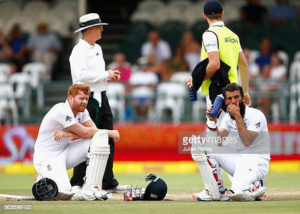 Jonny Bairstow and Moeen Ali of England wait for a stumping decision during day five of the 2nd Test at Newlands Stadium on January 6 2016 in Cape...
