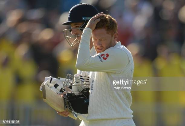 Jonny Bairstow and Toby RolandJones leave the field after the first day of the 4th Investec Test match between England and South Africa at Old...