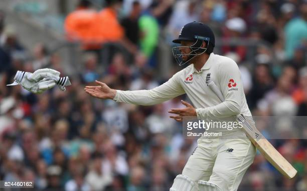 Jonny Bairstow of England changes his gloves during day four of the 3rd Investec Test match between England and South Africa at The Kia Oval on July...
