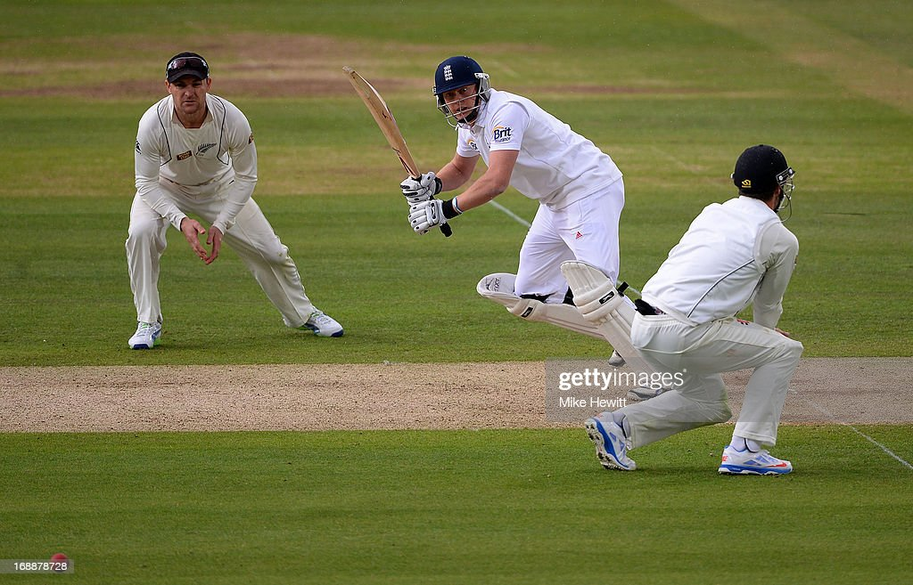 Jonny Bairstow of England hits a boundary as Brendon McCullum of New Zealand looks on during day one of 1st Investec Test match between England and New Zealand at Lord's Cricket Ground on May 16, 2013 in London, England.