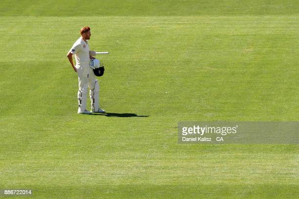 Jonny Bairstow of England looks on after being bowled out by Mitchell Starc of Australia during day five of the Second Test match during the 2017/18...