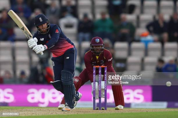 Jonny Bairstow of England plays to the onside as West Indies wicketkeeper Shai Hope looks on during the 5th Royal London One Day International match...