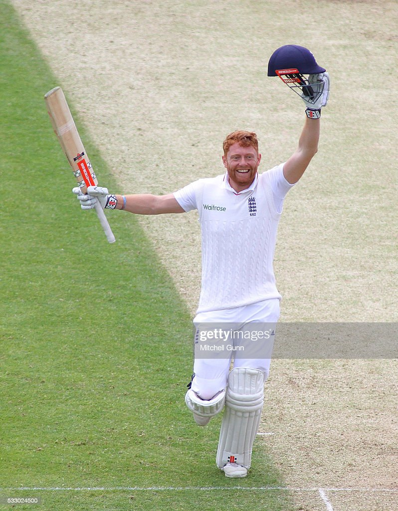 Jonny Bairstow of England raises his bat and celebrates scoring a century during day two of the Investec Test match England v Sri Lanka at Headingley Cricket Ground on May 20, 2016 in Leeds, England.
