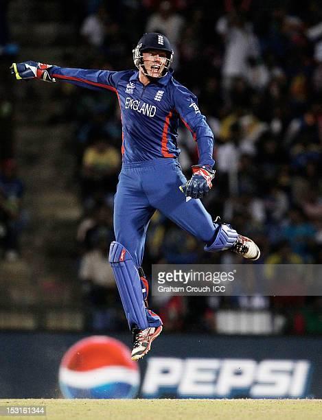 Jonny Bairstow of England reacts after taking a catch to dismiss Kumar Sangakkara of Sri Lanka during the Super Eights Group 1 match between England...