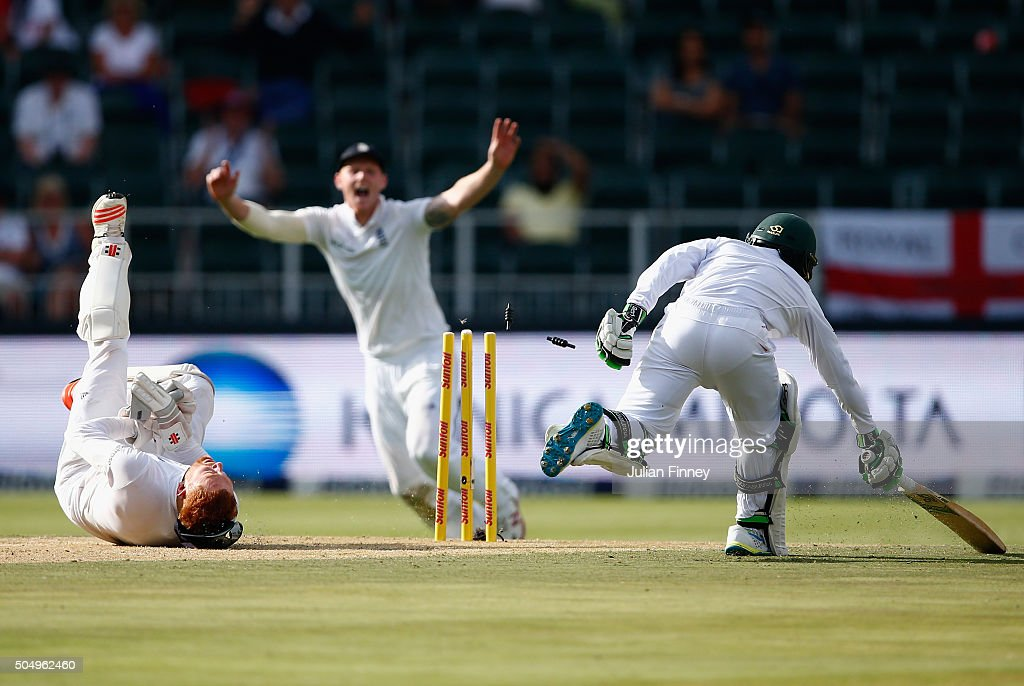 Jonny Bairstow of England runs out Temba Bavuma of South Africa from Chris Woakes's fielding off Stuart Broad of England's bowling during day one of...