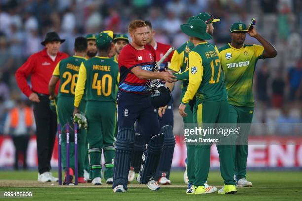 Jonny Bairstow of England shakes hands with AB de Villiers of South Africa after victory in the 1st NatWest T20 International match between England...