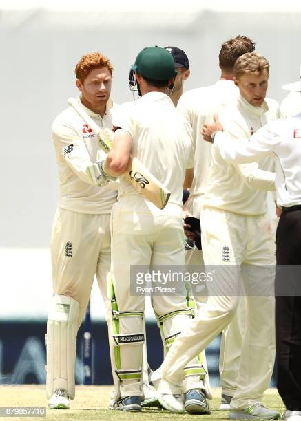 Jonny Bairstow of England shakes hands with Cameron Bancroft of Australia during day five of the First Test Match of the 2017/18 Ashes Series between...