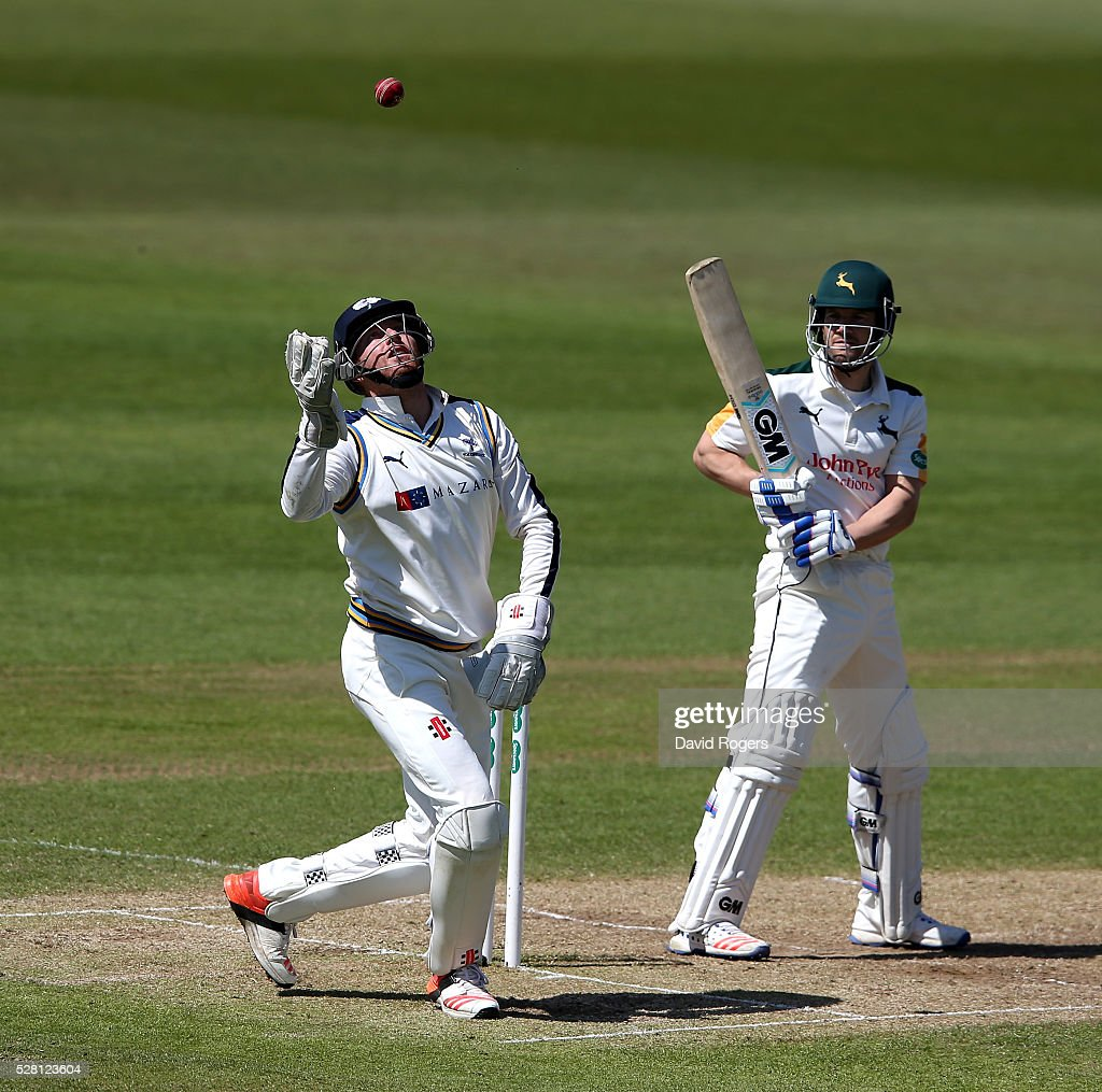 Jonny Bairstow of Yorkshire catches the ball as <a gi-track='captionPersonalityLinkClicked' href=/galleries/search?phrase=Chris+Read+-+Cricket+Player&family=editorial&specificpeople=211143 ng-click='$event.stopPropagation()'>Chris Read</a> looks on during the Specsavers County Championship division one match between Nottinghamshire and Yorkshire at Trent Bridge on May 4, 2016 in Nottingham, England.