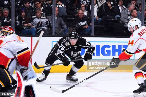 Jonny Brodzinski of the Los Angeles Kings battles for the puck against Matt Bartkowski of the Calgary Flames during the game on April 6 2017 at...