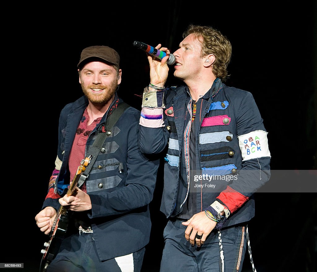 Jonny Buckland and Chris Martin of Coldplay perform at the Verizon Wireless Music Center on June 5, 2009 in Noblesville, Indiana.
