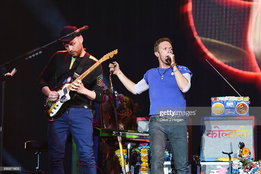 <a gi-track='captionPersonalityLinkClicked' href=/galleries/search?phrase=Jonny+Buckland&family=editorial&specificpeople=235773 ng-click='$event.stopPropagation()'>Jonny Buckland</a> and <a gi-track='captionPersonalityLinkClicked' href=/galleries/search?phrase=Chris+Martin+-+Musician&family=editorial&specificpeople=4468181 ng-click='$event.stopPropagation()'>Chris Martin</a> of Coldplay perform during day 2 of BBC Radio 1's Big Weekend at Powderham Castle on May 29, 2016 in Exeter, England.