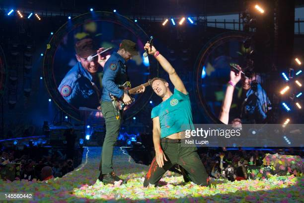 Jonny Buckland and Chris Martin of Coldplay perform on stage at Emirates Stadium on June 1 2012 in London United Kingdom