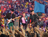 Jonny Buckland Chris Maritn and Guy Berryman of Coldplay perform onstage during the Pepsi Super Bowl 50 Halftime Show at Levi's Stadium on February 7...