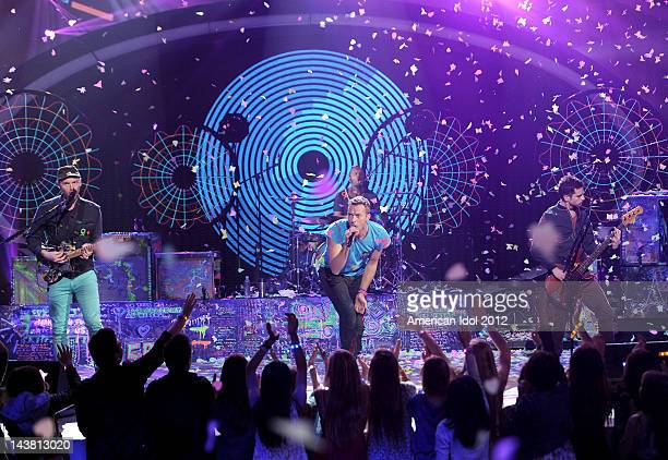 Jonny Buckland Chris Martin and Will Champion of Coldplay perform onstage at FOX's American Idol Season 11 Top 5 to 4 Live Elimination Show on May 3...