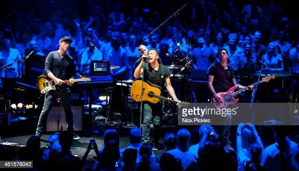 Jonny Buckland Chris Martin and Will Champion of Coldplay perform at Royal Albert Hall on July 1 2014 in London England