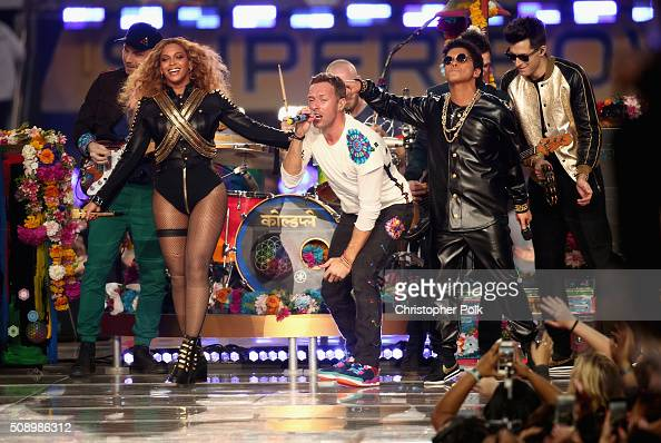 Jonny Buckland of Coldplay Beyonce Chris Martin of Coldplay Bruno Mars and Mark Ronson perform onstage during the Pepsi Super Bowl 50 Halftime Show...