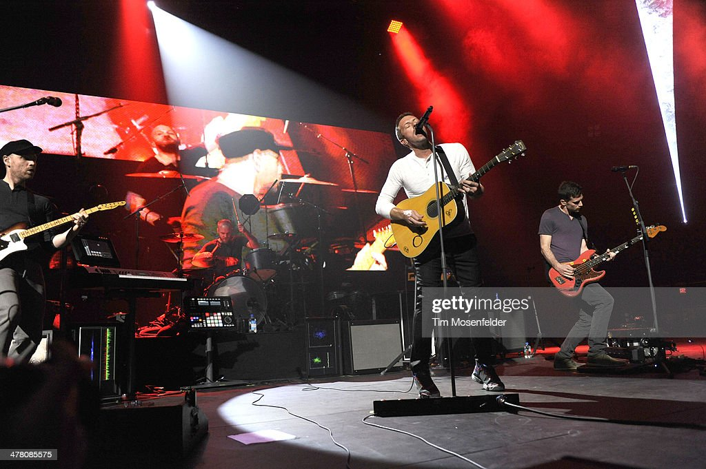 Jonny Buckland, Will Champion, Chris Martin, and Guy Berryman of Coldplay perform as part of the iTunes Festival at the Moody Theater on March 11, 2014 in Austin, Texas.