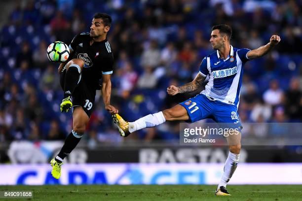 Jonny Castro of RC Celta de Vigo competes for the ball with Leo Baptistao of RCD Espanyol during the La Liga match between Espanyol and Celta de Vigo...