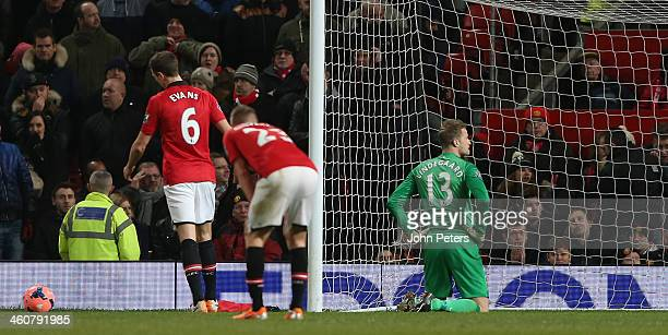 Jonny Evans and Anders Lindegaard of Manchester United react to conceding a goal to Wilfried Bony of Swansea City during the FA Cup Third Round match...