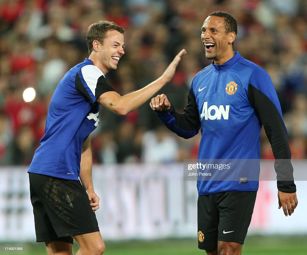 Jonny Evans and Rio Ferdinand of Manchester United in action during a first team training session as part of their pre-season tour of Bangkok, Australia, China, Japan and Hong Kong on July 19, 2013 in Sydney, Australia.