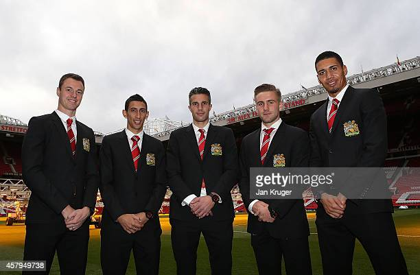 Jonny Evans Angel Di Maria Robin van Persie Luke Shaw and Chris Smalling pose during the Bulova AccuSwiss Squad Watch Collection launch at Old...