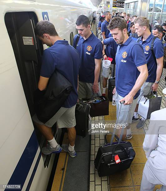 Jonny Evans Michael Keane Michael Carrick and Anders Lindegaard of Manchester United arrive at Yokohama station to travel to Osaka on the bullet...