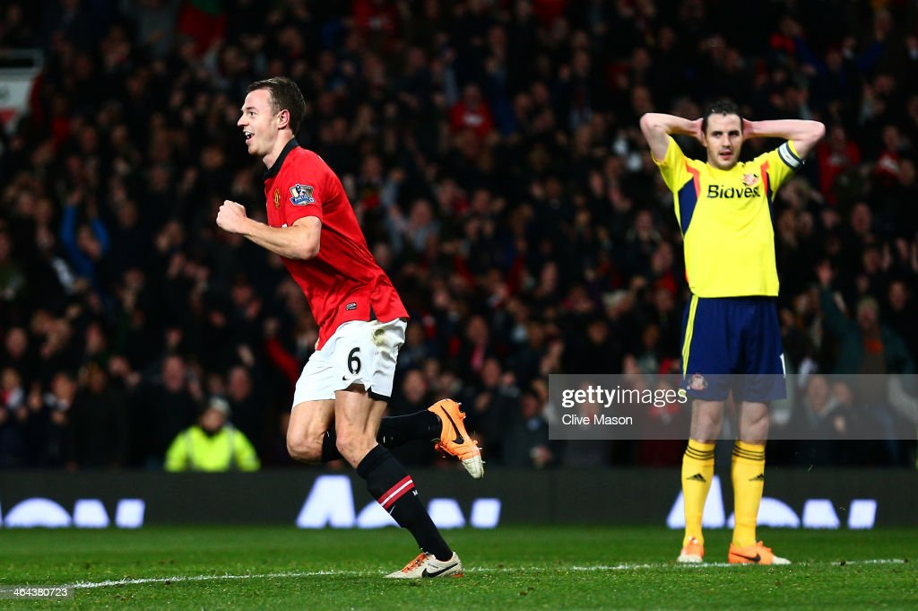 <a gi-track='captionPersonalityLinkClicked' href=/galleries/search?phrase=Jonny+Evans&family=editorial&specificpeople=747537 ng-click='$event.stopPropagation()'>Jonny Evans</a> of Manchester United celebrates after scoring the opening goal as a dejected <a gi-track='captionPersonalityLinkClicked' href=/galleries/search?phrase=John+O%27Shea+-+Soccer+Player&family=editorial&specificpeople=202487 ng-click='$event.stopPropagation()'>John O'Shea</a> of Sunderland looks on during the Capital One Cup semi final, second leg match between Manchester United and Sunderland at Old Trafford on January 22, 2014 in Manchester, England.