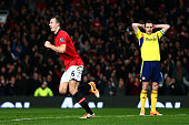 Jonny Evans of Manchester United celebrates after scoring the opening goal as a dejected John O'Shea of Sunderland looks on during the Capital One...