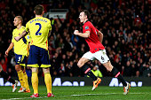 Jonny Evans of Manchester United celebrates after scoring the opening goal during the Capital One Cup semi final second leg match between Manchester...