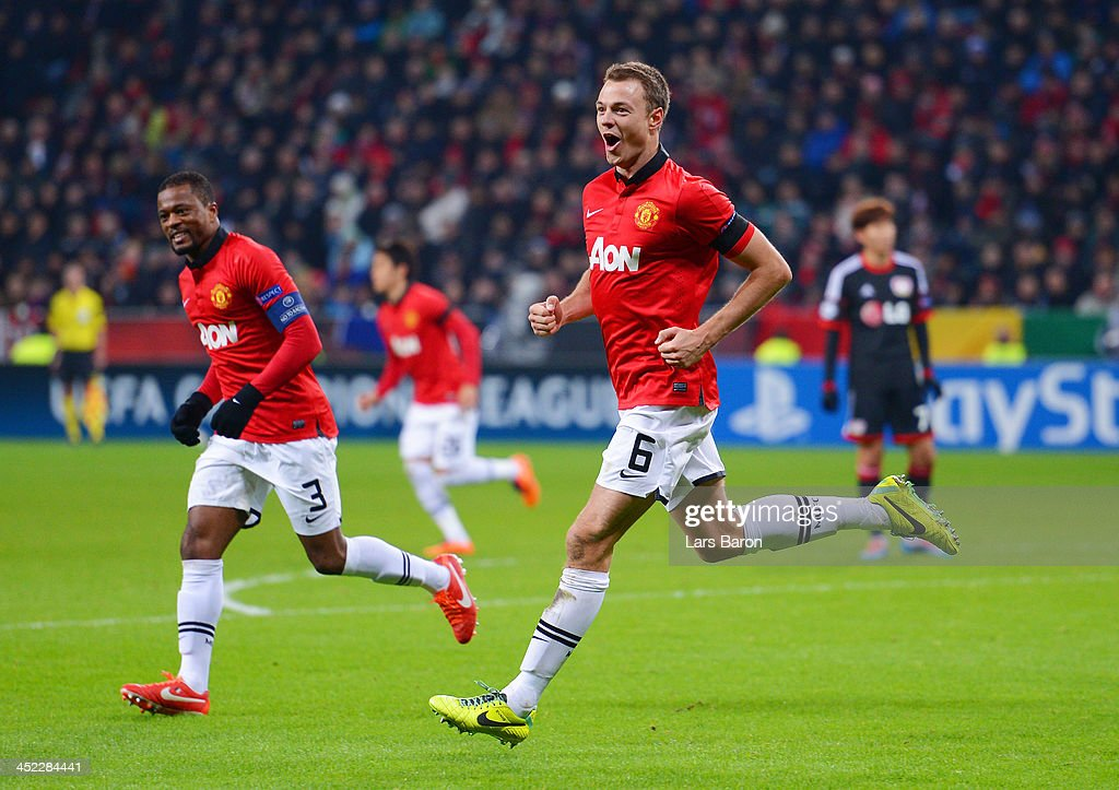 <a gi-track='captionPersonalityLinkClicked' href=/galleries/search?phrase=Jonny+Evans&family=editorial&specificpeople=747537 ng-click='$event.stopPropagation()'>Jonny Evans</a> of Manchester United celebrates with <a gi-track='captionPersonalityLinkClicked' href=/galleries/search?phrase=Patrice+Evra&family=editorial&specificpeople=714865 ng-click='$event.stopPropagation()'>Patrice Evra</a> of Manchester United after scoring their third goal during the UEFA Champions League Group A match between Bayer Leverkusen and Manchester United at BayArena on November 27, 2013 in Leverkusen, Germany.