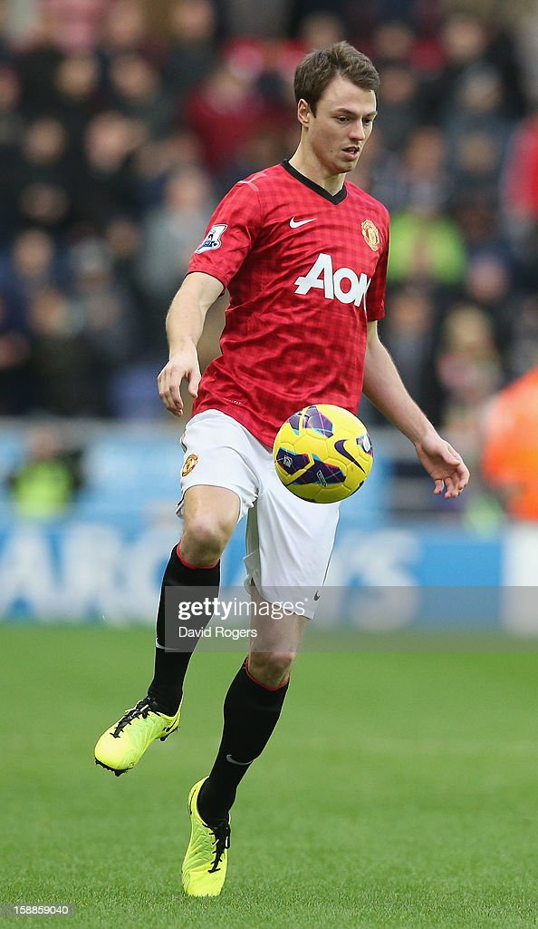 Jonny Evans of Manchester United controls the ball during the Barclays Premier League match between Wigan Athletic and Manchester United at the DW Stadium on January 1, 2013 in Wigan, England.