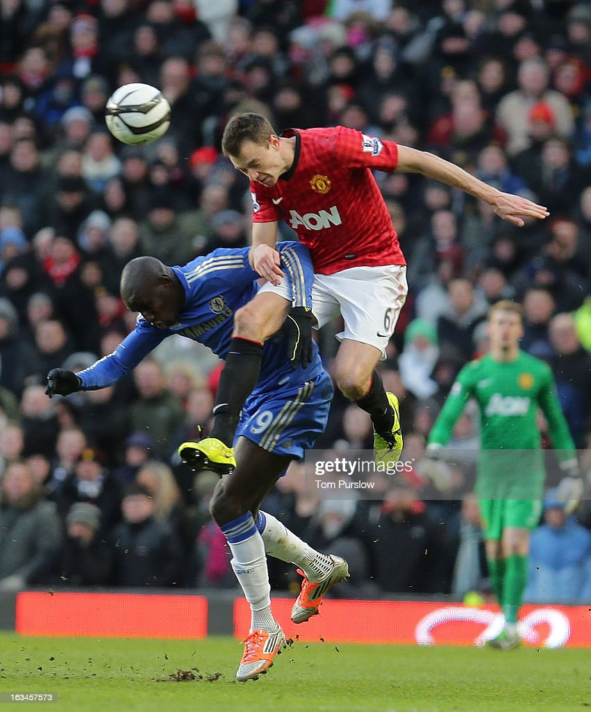 Jonny Evans of Manchester United in action with Demba Ba of Chelsea during the FA Cup Sixth Round match between Manchester United and Chelsea at Old Trafford on March 10, 2013 in Manchester, England.
