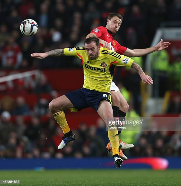 Jonny Evans of Manchester United in action with Steven Fletcher of Sunderland during the Capital One Cup semifinal second leg at Old Trafford on...