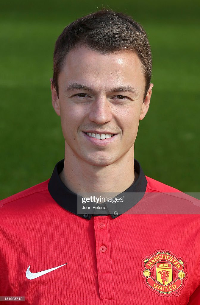 <a gi-track='captionPersonalityLinkClicked' href=/galleries/search?phrase=Jonny+Evans&family=editorial&specificpeople=747537 ng-click='$event.stopPropagation()'>Jonny Evans</a> of Manchester United poses at the annual club photocall at Old Trafford on September 26, 2013 in Manchester, England.