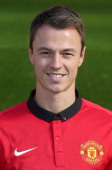 Jonny Evans of Manchester United poses at the annual club photocall at Old Trafford on September 26 2013 in Manchester England