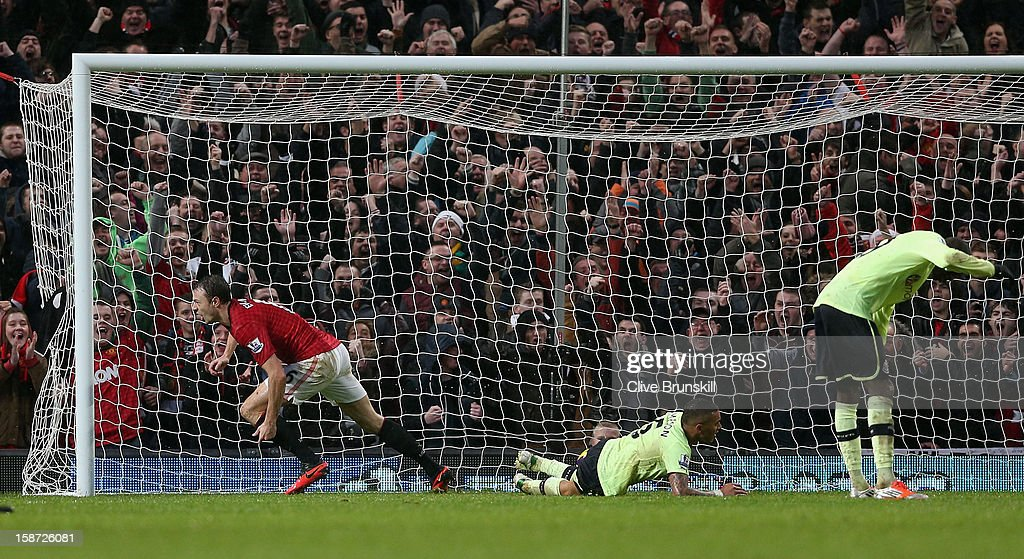 <a gi-track='captionPersonalityLinkClicked' href=/galleries/search?phrase=Jonny+Evans&family=editorial&specificpeople=747537 ng-click='$event.stopPropagation()'>Jonny Evans</a> of Manchester United runs away to celebrate after scoring his teams first goal during the Barclays Premier League match between Manchester United and Newcastle United at Old Trafford December 26, 2012 in Manchester, England.