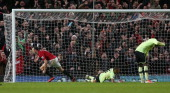 Jonny Evans of Manchester United runs away to celebrate after scoring his teams first goal during the Barclays Premier League match between...