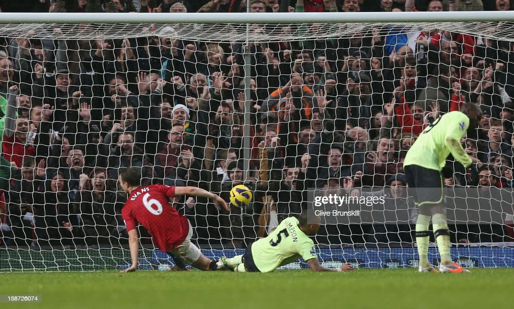 <a gi-track='captionPersonalityLinkClicked' href=/galleries/search?phrase=Jonny+Evans&family=editorial&specificpeople=747537 ng-click='$event.stopPropagation()'>Jonny Evans</a> of Manchester United scores his teams first goal during the Barclays Premier League match between Manchester United and Newcastle United at Old Trafford December 26, 2012 in Manchester, England.