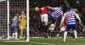 Jonny Evans of Manchester United scores their first goal during the Barclays Premier League match between Manchester United and Queens Park Rangers...
