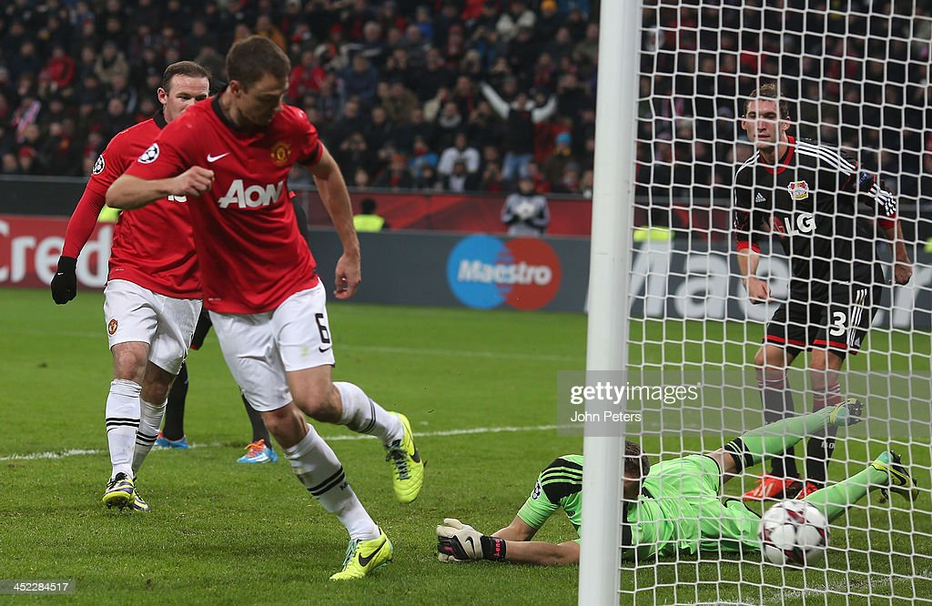 <a gi-track='captionPersonalityLinkClicked' href=/galleries/search?phrase=Jonny+Evans&family=editorial&specificpeople=747537 ng-click='$event.stopPropagation()'>Jonny Evans</a> of Manchester United scores their third goal during the UEFA Champions League Group A match between Bayer Leverkusen and Manchester United at BayArena on November 27, 2013 in Leverkusen, North Rhine-Westphalia.
