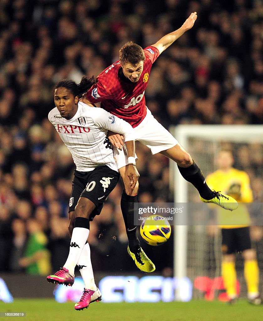 Jonny Evans of Manchester United wins the header over Hugo Rodallega of Fulham during the Barclays Premier League match between Fulham and Manchester United at Craven Cottage on February 2, 2013 in London, England.
